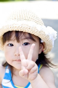 child peace sign